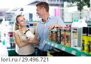 Купить «man and woman customers choosing can with protective furniture oil», фото № 29496721, снято 23 февраля 2019 г. (c) Яков Филимонов / Фотобанк Лори