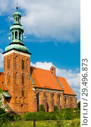 Купить «Old landmark Sw. Jana Chrzciciela is located in Gniezno, Poland», фото № 29496873, снято 11 мая 2018 г. (c) Яков Филимонов / Фотобанк Лори