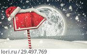 Купить «Video composition with snow over winter scene with red blank sign», видеоролик № 29497769, снято 15 декабря 2018 г. (c) Wavebreak Media / Фотобанк Лори
