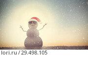 Купить «Video composition with snow over  sand man with santas hat on beach», видеоролик № 29498105, снято 14 декабря 2018 г. (c) Wavebreak Media / Фотобанк Лори