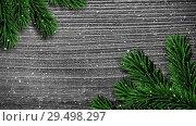 Купить «Video composition with snow over pine frame on wood», видеоролик № 29498297, снято 13 декабря 2018 г. (c) Wavebreak Media / Фотобанк Лори