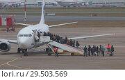 Купить «RUSSIA, MOSCOW. 8-11-2018. SHEREMETYEVO AIRPORT: People are landing on the airplane. Time lapse», видеоролик № 29503569, снято 11 декабря 2018 г. (c) Константин Шишкин / Фотобанк Лори
