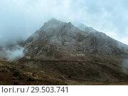 Купить «Moody gray gloomy mountain landscape with a rocky ridge among the clouds», фото № 29503741, снято 23 сентября 2017 г. (c) Евгений Харитонов / Фотобанк Лори