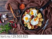 Купить «Spanish fried potatoes, eggs and chorizo sausages», фото № 29503825, снято 27 ноября 2018 г. (c) Oksana Zh / Фотобанк Лори