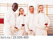 Купить «men and women fencers posing with foils togethe», фото № 29509489, снято 11 июля 2018 г. (c) Яков Филимонов / Фотобанк Лори