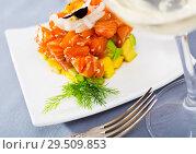 Купить «Cube of tasty tartar from red fish and avocado served on plate», фото № 29509853, снято 23 октября 2019 г. (c) Яков Филимонов / Фотобанк Лори
