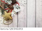 Купить «С Новым годом. Новогодняя композиция с еловыми ветками, часами и новогодними атрибутами. Открытка», фото № 29510013, снято 2 декабря 2018 г. (c) Наталья Осипова / Фотобанк Лори