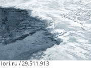 Купить «Ice hole on frozen river in winter season», фото № 29511913, снято 2 декабря 2018 г. (c) EugeneSergeev / Фотобанк Лори