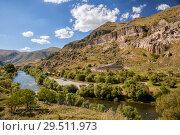 Купить «Kura River and ancient cave monastery Vardzia in Georgia», фото № 29511973, снято 25 сентября 2018 г. (c) Юлия Бабкина / Фотобанк Лори