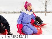 Купить «little girl on snow saucer sled in winter», фото № 29512121, снято 10 февраля 2018 г. (c) Syda Productions / Фотобанк Лори