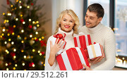 Купить «happy couple with christmas gifts at home», фото № 29512261, снято 7 октября 2012 г. (c) Syda Productions / Фотобанк Лори