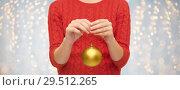 Купить «close up of woman in sweater with christmas ball», фото № 29512265, снято 10 сентября 2014 г. (c) Syda Productions / Фотобанк Лори