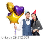 Купить «happy couple with party caps and balloons», фото № 29512369, снято 3 марта 2018 г. (c) Syda Productions / Фотобанк Лори
