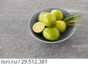 Купить «close up of whole limes in bowl», фото № 29512381, снято 4 апреля 2018 г. (c) Syda Productions / Фотобанк Лори