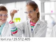 Купить «kids with test tubes studying chemistry at school», фото № 29512405, снято 19 мая 2018 г. (c) Syda Productions / Фотобанк Лори