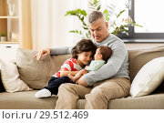 Купить «happy father with preteen and baby son at home», фото № 29512469, снято 14 апреля 2018 г. (c) Syda Productions / Фотобанк Лори