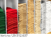Купить «close up of shelves with clothes at clothing store», фото № 29512637, снято 10 февраля 2018 г. (c) Syda Productions / Фотобанк Лори