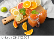 Купить «mason jar glass with juice and fruits on table», фото № 29512661, снято 4 апреля 2018 г. (c) Syda Productions / Фотобанк Лори