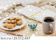 Купить «cookies, tea and candle at home over snow», фото № 29512697, снято 15 ноября 2017 г. (c) Syda Productions / Фотобанк Лори
