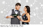 Купить «happy couple with champagne celebrating christmas», фото № 29512753, снято 15 декабря 2017 г. (c) Syda Productions / Фотобанк Лори