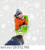 Купить «happy boy riding sled on snow in winter», фото № 29512765, снято 10 февраля 2018 г. (c) Syda Productions / Фотобанк Лори