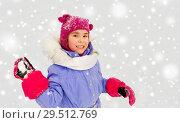 Купить «happy girl playing and throwing snowball in winter», фото № 29512769, снято 10 февраля 2018 г. (c) Syda Productions / Фотобанк Лори