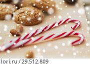 Купить «candy canes, cookies and almonds on board», фото № 29512809, снято 15 ноября 2017 г. (c) Syda Productions / Фотобанк Лори