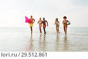 Купить «friends run with beach ball and swimming mattress», фото № 29512861, снято 29 июля 2018 г. (c) Syda Productions / Фотобанк Лори
