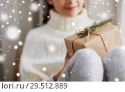 Купить «girl with christmas gift sitting on sill at home», фото № 29512889, снято 5 ноября 2016 г. (c) Syda Productions / Фотобанк Лори