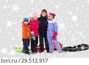 Купить «happy little kids with sleds hugging in winter», фото № 29512917, снято 10 февраля 2018 г. (c) Syda Productions / Фотобанк Лори