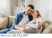 Купить «man hugging pregnant woman at home», фото № 29512997, снято 4 ноября 2017 г. (c) Syda Productions / Фотобанк Лори