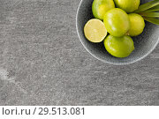 Купить «close up of whole limes in bowl», фото № 29513081, снято 4 апреля 2018 г. (c) Syda Productions / Фотобанк Лори