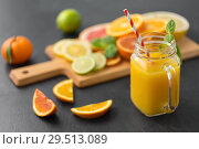 Купить «mason jar glass of fruit juice on slate table top», фото № 29513089, снято 4 апреля 2018 г. (c) Syda Productions / Фотобанк Лори