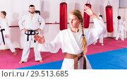 Купить «girl practicing taekwondo», фото № 29513685, снято 22 февраля 2019 г. (c) Яков Филимонов / Фотобанк Лори