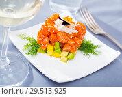 Купить «Salmon tartare formed as cube with avocado», фото № 29513925, снято 24 января 2019 г. (c) Яков Филимонов / Фотобанк Лори
