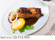 Купить «Broiled pork ribs in chocolate sauce with baked potato», фото № 29513993, снято 17 июля 2019 г. (c) Яков Филимонов / Фотобанк Лори