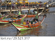 Купить «Taxi boats, Yangon river, Yangon town, Myanmar, Asia.», фото № 29521317, снято 31 марта 2018 г. (c) age Fotostock / Фотобанк Лори