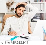 Купить «Manager immersed in work», фото № 29522941, снято 22 мая 2019 г. (c) Яков Филимонов / Фотобанк Лори
