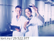 Купить «Young two experts examining wine», фото № 29522977, снято 19 января 2019 г. (c) Яков Филимонов / Фотобанк Лори