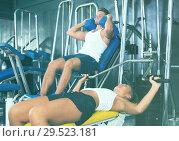 Купить «Young woman lifting weights in gym», фото № 29523181, снято 19 марта 2019 г. (c) Яков Филимонов / Фотобанк Лори