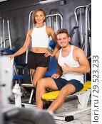 Купить «man and woman fitness coaches in gym», фото № 29523233, снято 4 октября 2016 г. (c) Яков Филимонов / Фотобанк Лори