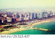 Купить «Aerial view of Residence district at Mediterranean city. Barcelona», фото № 29523437, снято 8 июля 2016 г. (c) Яков Филимонов / Фотобанк Лори