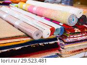 Купить «Stack of multicolored quality rugs at carpet shop», фото № 29523481, снято 22 ноября 2017 г. (c) Яков Филимонов / Фотобанк Лори