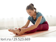 Купить «woman doing yoga exercise at studio», фото № 29523669, снято 21 июня 2018 г. (c) Syda Productions / Фотобанк Лори