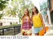 Купить «teenage girls with short skateboards in city», фото № 29523693, снято 19 июля 2018 г. (c) Syda Productions / Фотобанк Лори
