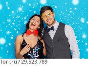 Купить «happy couple with party props having fun», фото № 29523789, снято 15 декабря 2017 г. (c) Syda Productions / Фотобанк Лори