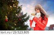 Купить «woman with coffee over christmas tree in tallinn», фото № 29523805, снято 7 января 2017 г. (c) Syda Productions / Фотобанк Лори