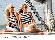 Купить «beautiful women traveling by sail boat or yacht», фото № 29523841, снято 13 июля 2014 г. (c) Syda Productions / Фотобанк Лори