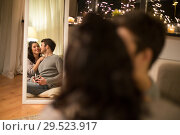 Купить «mirror reflection of couple with camera at home», фото № 29523917, снято 13 января 2018 г. (c) Syda Productions / Фотобанк Лори