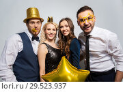 Купить «happy friends with golden party props posing», фото № 29523937, снято 3 марта 2018 г. (c) Syda Productions / Фотобанк Лори